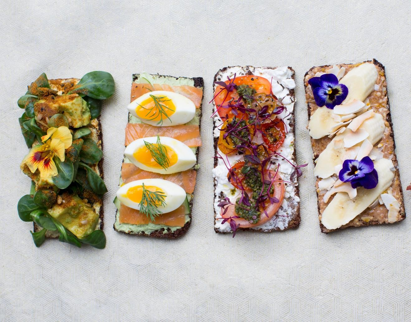 Avocado, egg, smoked salmon and chicken breakfast toasts by Bel|Air