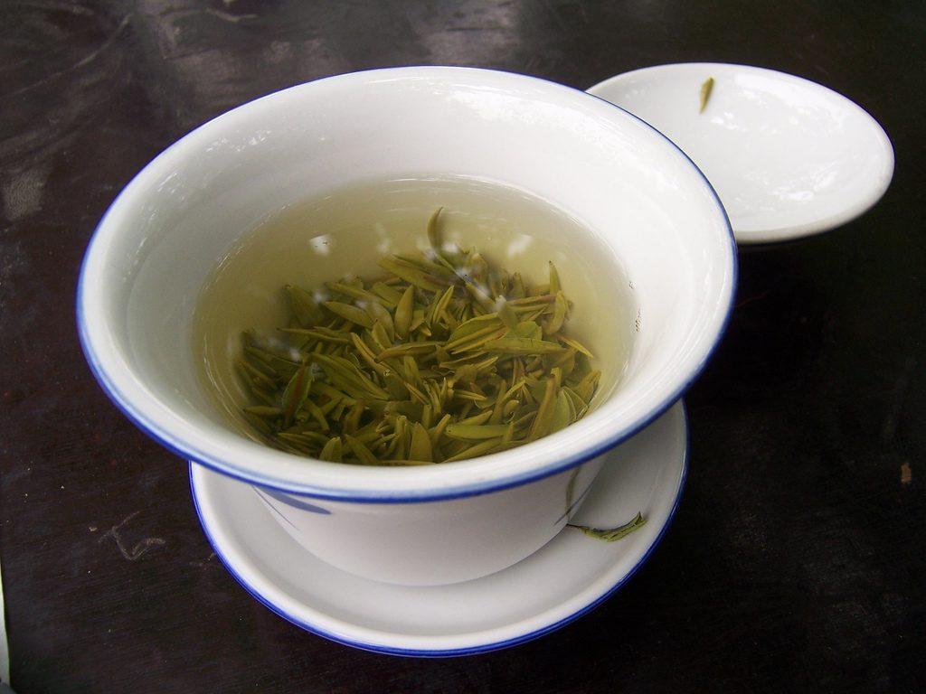 A mug of loose leaf green tea.