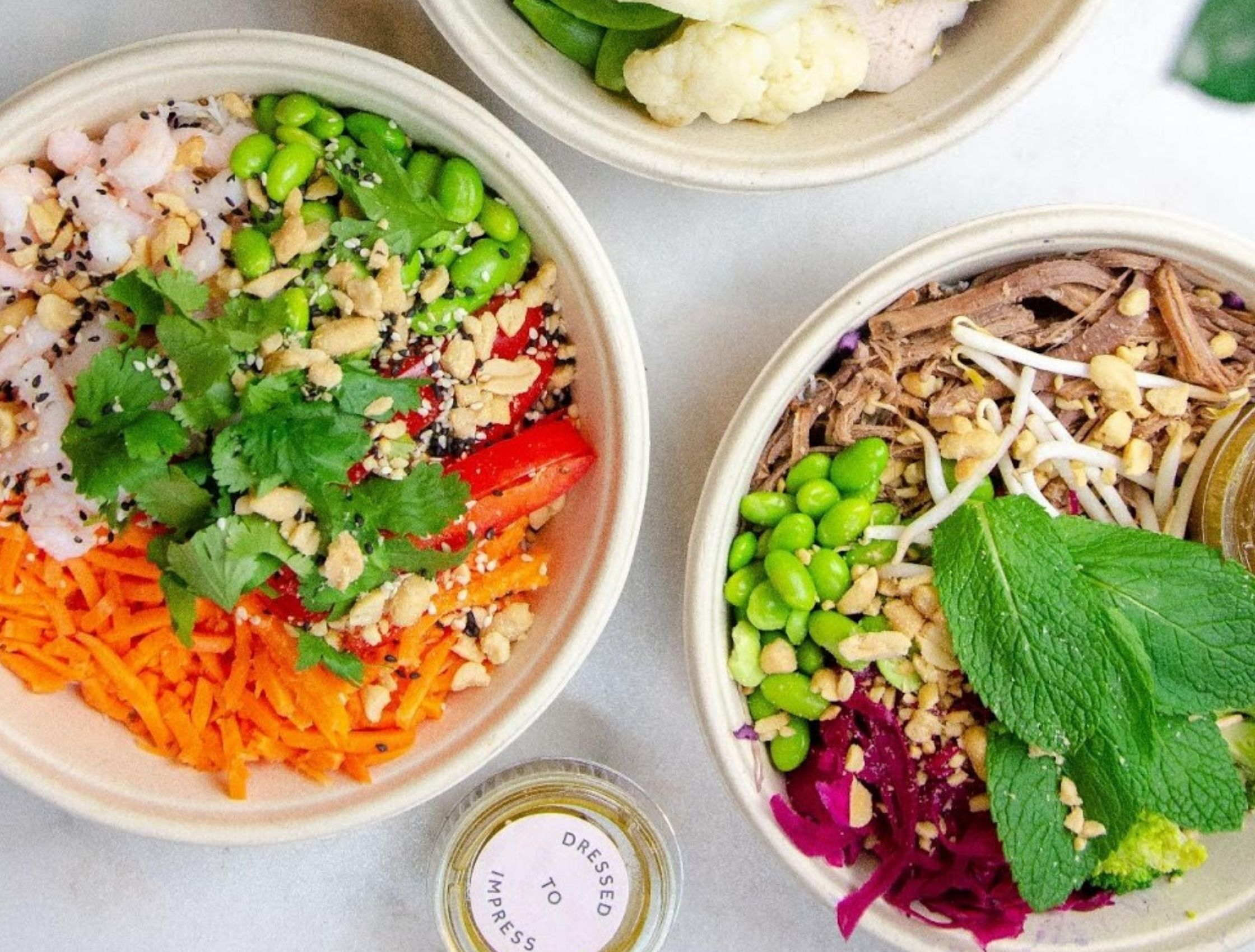 Urban Greens salad bowls with fresh nutritious ingredients